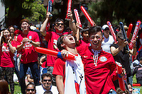 Los Angeles, CA -  Sunday, June 22, 2014: Koreans fans celebrate a South Korea goal while watching the South Korea vs. Algeria first round match on the  front lawn of Wilshire Park Place.