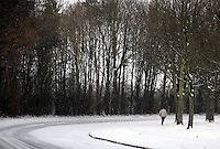 Hertfordshire - Snow scenes in Hertfordshire. Pictured - Woman walks on snow covered path in Letchworth - January 18th 2012..Photo by Keith Mayhew