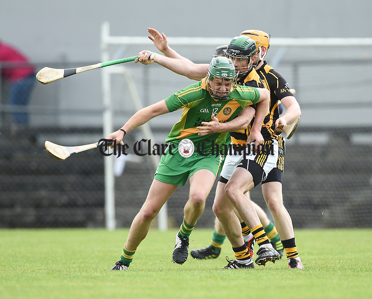 Jacob Loughnane of O Callaghan's Mills in action against Conor Earley of Tubber during their match in Ennis. Photograph by John Kelly.