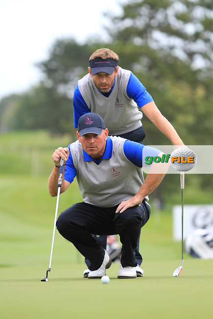 Raphael Jacqueline (FRA) and Thomas Bjorn (dEN) on the 2nd green playing the 1st Match on Day 2 of the Vivendi Seve Trophy at Golf De Saint-Nom-La-Breteche, France...Photo Golffile/Jenny Matthews.(Photo credit should read Jenny Matthews www.golffile.ie)....This Picture has been sent you under the conditions enclosed by:.Newsfile Ltd..The Studio,.Millmount Abbey,.Drogheda,.Co Meath..Ireland..Tel: +353(0)41-9871240.Fax: +353(0)41-9871260.GSM: +353(0)86-2500958.email: pictures@newsfile.ie.www.newsfile.ie.