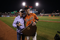 SAN FRANCISCO, CA - OCTOBER 2:  Matt Duffy #5 of the San Francisco Giants poses for a picture his father Tom Duffy on the field after ceremonies honoring Duffy for winning the Willie Mac Award, named after former Giants great Willie McCovey, before the game against the Colorado Rockies at AT&T Park on Friday, October 2, 2015 in San Francisco, California. Photo by Brad Mangin