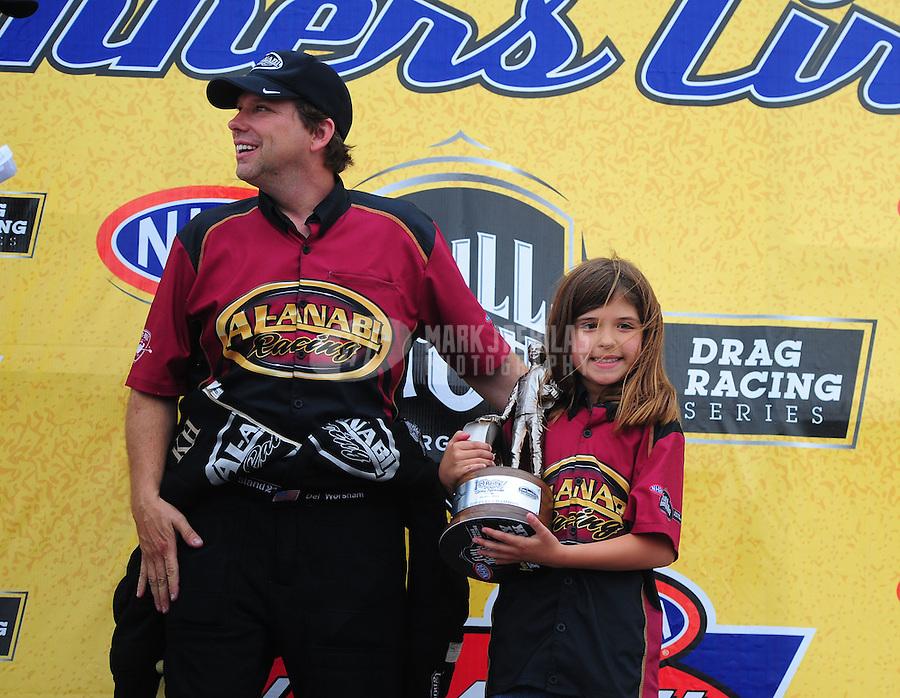 May 1, 2011; Baytown, TX, USA: NHRA top fuel dragster driver Del Worsham celebrates with his daughter after winning the Spring Nationals at Royal Purple Raceway. Mandatory Credit: Mark J. Rebilas-