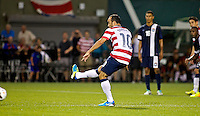 PORTLAND, Ore. - July 9, 2013: Landon Donovan converts a penalty kick in the second half. The US Men's National team plays the National team of Belize during the 2013 Gold Cup at at JELD-WEN Field.
