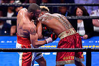 """Fairfax, VA - May 11, 2019: Julian J-Rock"""" Williams lands a body shot during Jr. Middleweight title fight against Jarrett """"Swift"""" Hurd at Eagle Bank Arena in Fairfax, VA. Julian Williams defeated Hurd to take home the IBF, WBA and IBO Championship belts by unanimous decision. (Photo by Phil Peters/Media Images International)"""