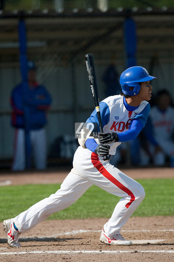 14 September 2009: Jong-Wook Ko of South Korea hits the ball during the 2009 Baseball World Cup Group F second round match game won 15-5 by South Korea over Great Britain, in the Dutch city of Amsterdan, Netherlands.
