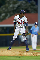 Danville Braves relief pitcher Albinson Volquez (56) looks to his catcher for the sign against the Burlington Royals at Burlington Athletic Stadium on August 9, 2019 in Burlington, North Carolina. The Royals defeated the Braves 6-0. (Brian Westerholt/Four Seam Images)