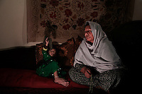 The only known female Mujahideen commander, Kaftar, was once the leader of a 600-strong armed force. Today she can&rsquo;t even leave the safe house where she is staying as a guest along with her 3-year-old granddaughter, Bibi Zora. Her enemies, mostly from the neighboring village, are looking for her to settle an old score. According to local accounts, her husband failed to avenge the murder of a relative &ndash; Bibi, as she is called by her eight children, took matters into her own hands and soon after enlisted with the Jamiyat-e-Islami forces of Ahmad Shah Massoud&rsquo;s forces at the height of the Soviet invasion of Afghanistan in the early 80&rsquo;s. Born in Bahglan province, Kaftar is proud to have never surrendered to the Taliban &ndash; in fact, her area of operations never fell to the militants onslaught. Like many other Jihadi commanders, Kaftar surrendered her weapons as part of the UN Disbandment of Illegal Armed Groups program (DIAG) &ndash; however, she kept some small arms for herself and her personal guards. One of these weapons is her Russian-made Makarov pistol, which she always carries on a holster under her shoulder. <br /> Like many other warlords (and former Mujahideen) in Afghanistan, Kaftar used the power of the gun for extortion and self-enrichment. Several residents of her native village of Khoza claim that she is responsible for at least ten deaths along with demanding tax money and extortion from the locals in order to fund her operations. Like many other warlords in Afghanistan, the central and local governments have not made any effort to bring her to justice.