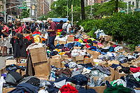 A jumble of clothing in boxes for sale at a street fair in the Upper West side neighborhood of New York on Sunday, May 28, 2017. (© Richard B. Levine)