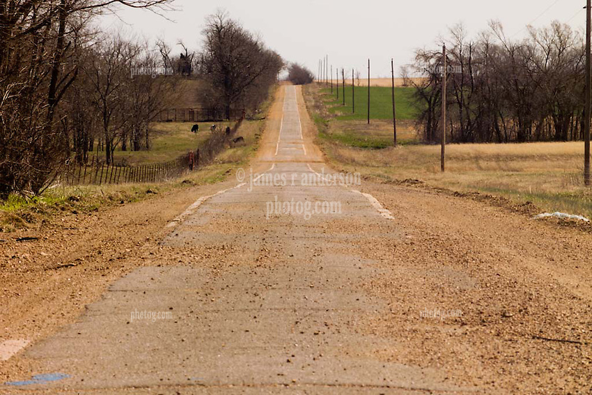 "Old US Route 66 south of Miami Oklahoma. An Original alignment consisting of Portland Cement less than15 feet wide here, sometimes refered to as ""Sidewalk Highway"". This is just south of the 8' wide section. Location E 130 Rd, View East."