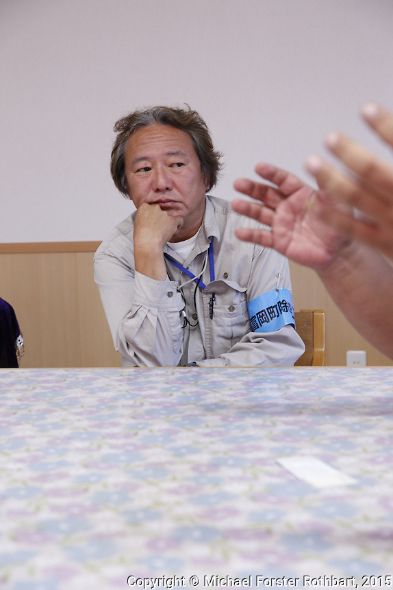 Civil engineer Kenichi Hayashi is one of 15,800 evacuees from Tomioka, a town in the Fukushima exclusion zone. He is also a decontamination supervisor working for Maruto, a construction company cleaning up Tomioka. Hayashi and his friend Ben Takeda, another decontamination supervisor, answer questions in his Maruto office. Full caption to come.<br /> <br /> &copy; Michael Forster Rothbart Photography<br /> www.mfrphoto.com &bull; 607-267-4893<br /> 34 Spruce St, Oneonta, NY 13820<br /> 86 Three Mile Pond Rd, Vassalboro, ME 04989<br /> info@mfrphoto.com<br /> Photo by: Michael Forster Rothbart<br /> Date:  10/2/2015<br /> File#:  Canon &mdash; Canon EOS 5D Mark III digital camera frame A19349