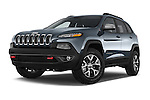 Stock pictures of low aggressive front three quarter view of a 2014 Volkswagen Cherokee Trailhawk 4X4 5 Door SUV