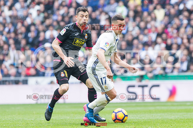 Javi Fuego of RCD Espanyol competes for the ball with Lucas Vazquez of Real Madrid during the match of La Liga between Real Madrid and RCE Espanyol at Santiago Bernabeu  Stadium  in Madrid , Spain. February 18, 2016. (ALTERPHOTOS/Rodrigo Jimenez) /Nortephoto.com