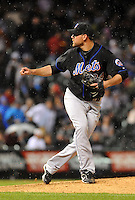 10 MAY 2011: New York Mets starting pitcher Mike Pelfrey (34) as the rain falls during a regular season game between the New York Mets and the Colorado Rockies at Coors Field in Denver, Colorado. The Mets led after 6 2/3 innings, 4-3, when the game was delayed. *****For Editorial Use Only*****