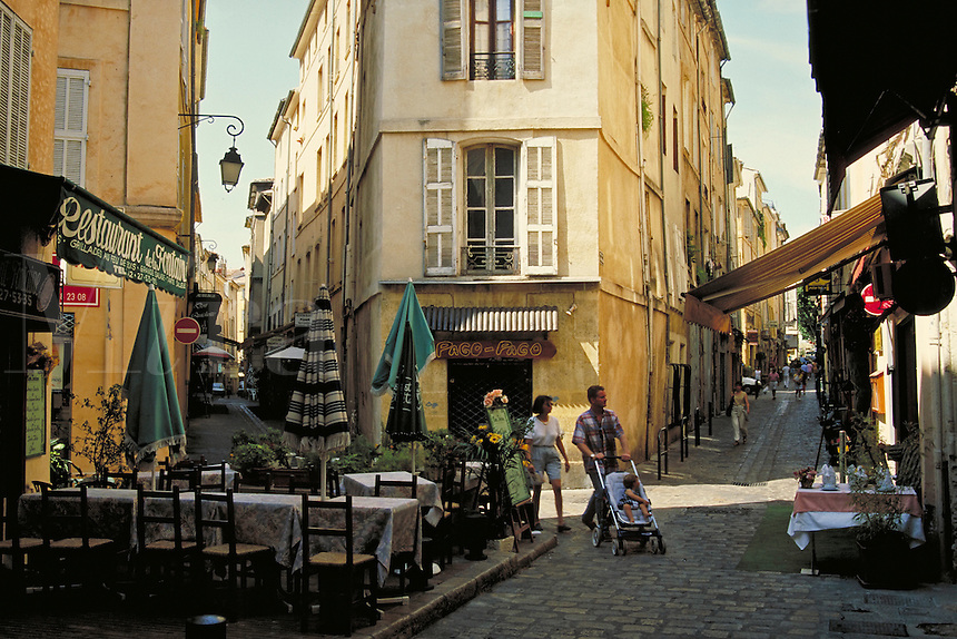 Restaurant de la Fontaine at apex where narrowly diverging streets cross. Aix en Provence, France.