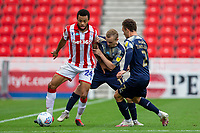 4th July 2020; Bet365 Stadium, Stoke, Staffordshire, England; English Championship Football, Stoke City versus Barnsley; Jordan Cousins of Stoke City under pressure from Luke Thomas and Jordan Williams of Barnsley