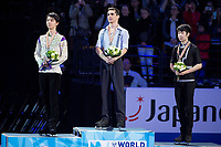 Friday, April 1, 2016: Yuzuru Hanyu (JPN), Javier Fernandez (ESP), and Boyang Jin (CHN) (L to R) watch the the raising of their country's flags during the awards ceremony at the International Skating Union World Championship held at TD Garden, in Boston, Massachusetts.  Javier Fernandez (ESP) won the gold medal, Yuzuru Hanyu (JPN) won silver and Boyang Jin (CHN) won the bronze medal. Eric Canha/CSM
