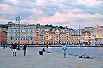 Molo Audace pier with a view of Piazza Unita d'Italia in the background at sunset in Trieste, Italy