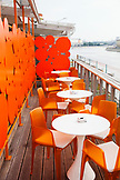 RUSSIA, Moscow. Tables at the roof restaurant at Bar Strelka which overlooks the Moscow River.