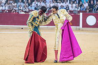 Bullfighter Enrique Ponce helps Bullfighter Cayetano Rivera after gored by bull at La Misericordia bullround during the 5th bullfighting Fest in Zaragoza, NW of Spain on October 11, 2017.