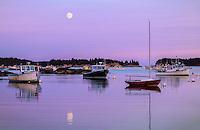 Stonington, ME: Moonrise reflected in Stonington Harbor at dusk