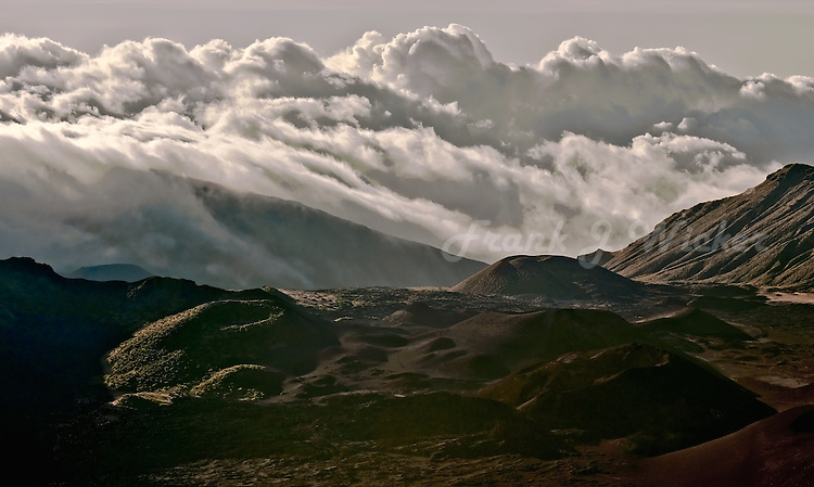Massive storm clouds enshroud the crater of HALEAKALA NATIONAL PARK on Maui in Hawaii