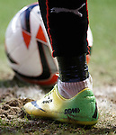 Arnold Peralta's green and yellow boots