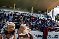 Two ladies wearing hats buy Icecream at the Darby at Ngong Racecourse in Naiorbi Kenya on Derby Day April 14, 2013. Nairobi, Kenya. Photo: Brendan Bannon