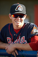 Peoria Chiefs outfielder Blake Drake (12) in the dugout before a game against the Lansing Lugnuts on June 6, 2015 at Cooley Law School Stadium in Lansing, Michigan.  Lansing defeated Peoria 6-2.  (Mike Janes/Four Seam Images)