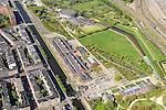 Nederland, Noord-Holland, Amsterdam, 09-04-2014;<br /> Cultuurpark Westergasfabriek en Westerpark op het voormalige  Westergasterrein, langs de Haarlemmertrekvaart en de Haarlemmerweg. Links van het kanaal woonwijk de multiculturele Staatsliedenbuurt en bij oude watertoren de nieuwbouw Waterwijk. Spoorbanen rechts.<br /> <br /> Culture park Westergasfabriek and the Westerpark on the former Westergasterrein (gasworks), and residential district on the other side of the channel.<br /> luchtfoto (toeslag op standard tarieven);<br /> aerial photo (additional fee required);<br /> copyright foto/photo Siebe Swart