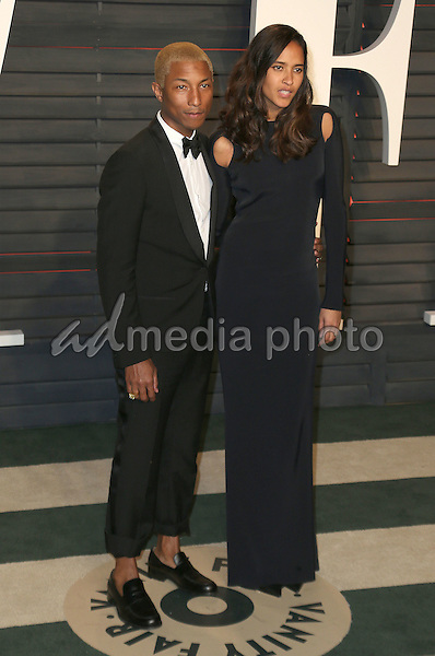 28 February 2016 - Beverly Hills, California - Pharrell Williams, Helen Lasichanh. 2016 Vanity Fair Oscar Party hosted by Graydon Carter following the 88th Academy Awards held at the Wallis Annenberg Center for the Performing Arts. Photo Credit: Byron Purvis/AdMedia