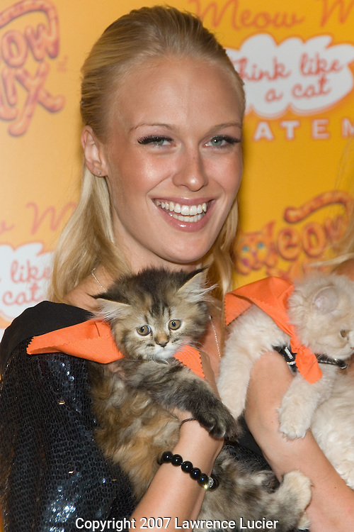 NEW YORK - AUGUST 20: Model Caridee English arrives at the Meow Mix Acatemy Orange Carpet Party August 20, 2007, at the Daryl Roth Theater in New York City.  (Photo by Lawrence Lucier)