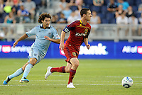Will Johnson Real Salt Lkae midfielder pursued by Graham Zusi Sporting KC... Sporting Kansas City defeated Real Salt Lake 2-0 at LIVESTRONG Sporting Park, Kansas City, Kansas.