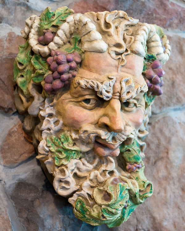 A bust of the god of wine and celebration, Bacchus, on the wall in the tasting room at Breaux Vineyards.