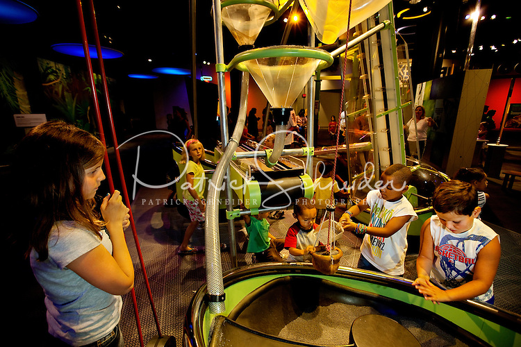 Visitors to Charlotte's Discovery Place museum check out Kid Science, an interactive hands-on learning lab created to inspire inquiry-based  learning. Discovery Place, Charlotte NC's interactive children's museum, unveiled its interactive exhibits and hands-on activities in June 2010. Renovations of the popular family museum were made possible by the City of Charlotte, the Arts and Science Council and private donations. Discovery Place museum has age-appropriate exhibits for kids of all ages.