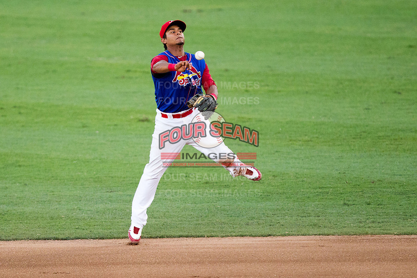 Donovan Solano (11) of the Springfield Cardinals leaps and throws a ball to first during a game against the Corpus Christi Hooks at Hammons Field on August 13, 2011 in Springfield, Missouri. Springfield defeated Corpus Christi 8-7.  (David Welker / Four Seam Images)