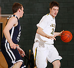 SPEARFISH, SD - FEBRUARY 2, 2013:  Riley Ryan #32 of Black Hills State drives on Mitch McCarron #10 of Metro State during their Rocky Mountain Athletic Conference men's basketball game Saturday evening at the Donald Young Center in Spearfish, S.D.  (Photo by Richard Carlson/dakotapress.org)