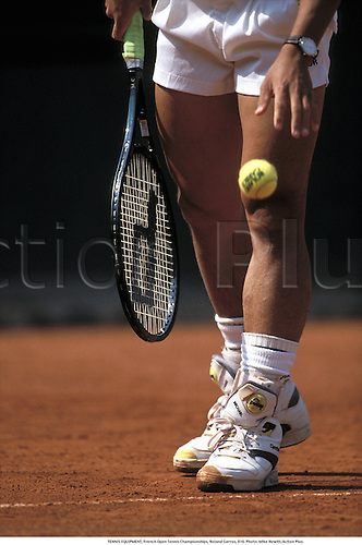 TENNIS EQUIPMENT, French Open Tennis Championships, Roland Garros, 910. Photo: Mike Hewitt/Action Plus....1991.  detail.sports equipment. s.  ident.tennis.ball balls.racket racquet.shoes.closeup close up close-up.illustration.leg legs.hand hands