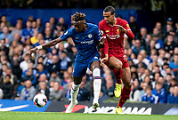 Fabinho of Liverpool and Tammy Abraham of Chelsea during the Premier League match between Chelsea and Liverpool at Stamford Bridge, London, England on 22 September 2019. Photo by Liam McAvoy / PRiME Media Images.