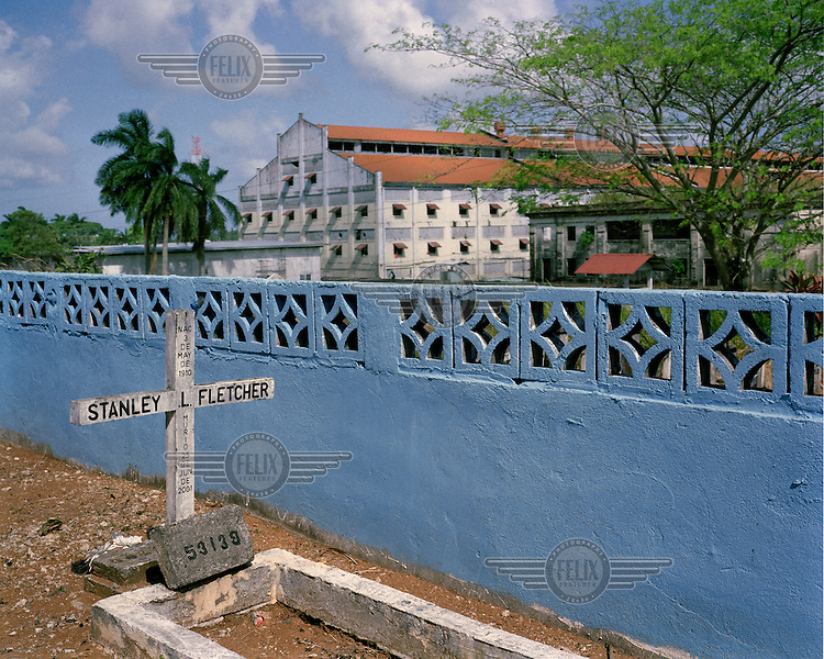 The Mount Hope Cemetery (Cementerio de Monte Esperanza) in Colon, where 'Silver Roll' (Afro-Antillean, non-US, non-white) workers and their dependents were buried during and after the construction period of the Panama Canal (1904-1914). In the background is 'New Hope' Prison (Prision Nueva Esperanza) which was established in 1996 on the site of the former Panama Canal Commission <br /> <br /> The Panama Canal Zone is an area extending 8kms out, in each direction, from the waterway's central line, was a territory controlled by the United States between 1903 and 1979. After a 20 year period of joint administration, the Canal came under the full control of Panama in 1999. The Canal opened to shipping in 1914 and during its tenure was of great strategic importance to the US, enabling it to rapidly move its naval fleet between the Atlantic and Pacific Oceans. However, its economic value came not directly from shipping fees but from the stimulus to trade that the waterway created. One hundred years after it opened in 2014 it is due to have its locks upgraded to cater for the super sized container ships of the 21st Century.  <br /> During the era of American administration thousands of US citizens populated the Canal Zone, living and working under US law in towns built to American standards. Not all of these people returned north after the canal came under full Panamanian control many stayed on, their identities tied to the region.