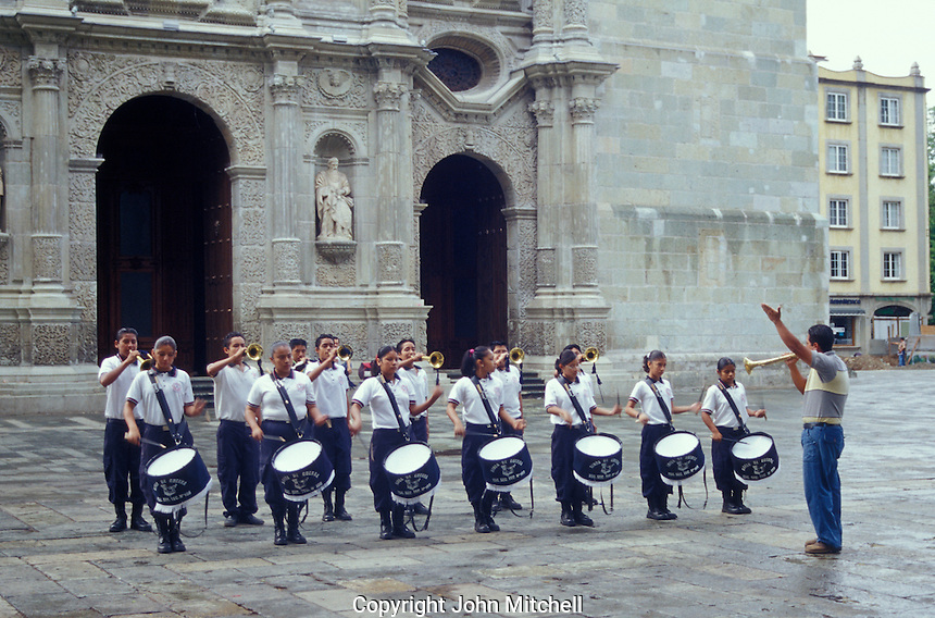 Children's marching band performing in front of the cathedral in the city of Oaxaca, Mexico