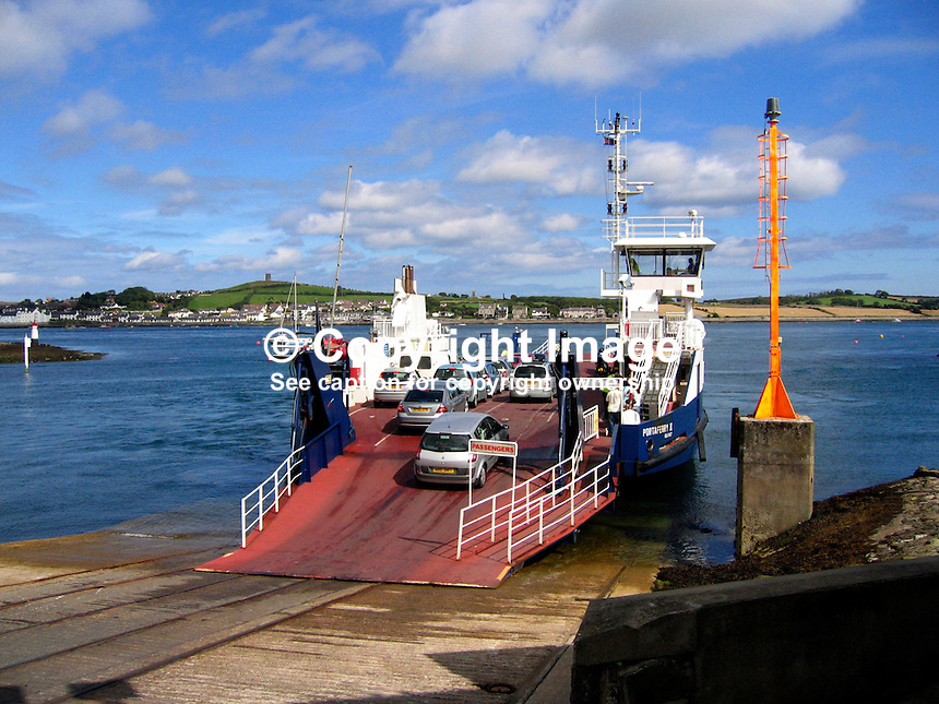 Vehicles board Strangford-Portaferry car ferry at Strangford, Co Down, N Ireland. The ferry connects the two towns at the mouth of Strangford Lough where it enters the Irish Sea. 200708250107..Copyright Image from Victor Patterson, 54 Dorchester Park, Belfast, UK, BT9 6RJ..Tel: +44 28 9066 1296.Mob: +44 7802 353836.Voicemail +44 20 8816 7153.Skype: victorpattersonbelfast.Email: victorpatterson@mac.com.Email: victorpatterson@ireland.com (back-up)..IMPORTANT: If you wish to use this image or any other of my images please go to www.victorpatterson.com and click on the Terms & Conditions. Then contact me by email or phone with the reference number(s) of the image(s) concerned.