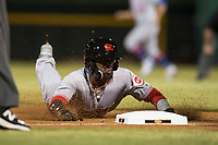 Scottsdale Scorpions second baseman Shed Long (6), of the Cincinnati Reds organization, slides into third base during an Arizona Fall League game against the Mesa Solar Sox at Sloan Park on October 10, 2018 in Mesa, Arizona. Scottsdale defeated Mesa 10-3. (Zachary Lucy/Four Seam Images)
