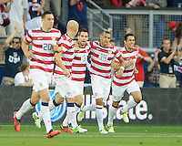 Kansas City, Kansas, October 16, 2012: The USA 3-1 over Guatemala at Livestrong Sporting Park in the semi-final round of 2014 FIFA World Cup Qualifying. Carlos Bocanegra is congratulated on his goal.