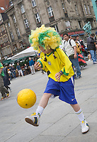 Germany, DEU, Dortmund, 2006-Jun-22: FIFA football world cup (USA: soccer world cup) 2006 in Germany; a young female fan of the Brazilian football team juggling with a ball in the city.