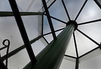Interior of the Tropical Rainforest Glasshouse (formerly Le Jardin d'Hiver or Winter Gardens), 1936, René Berger, Jardin des Plantes, Museum National d'Histoire Naturelle, Paris, France. View from below of the turret at the top of the stairway to the roof, showing the geometric pattern of the glass and metal structure.