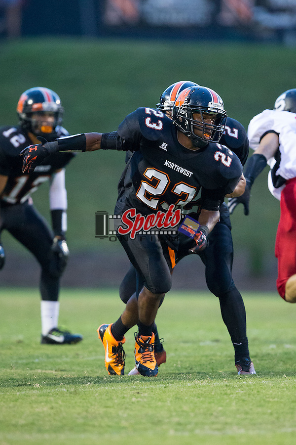 Isaiah Williams (23) of the Northwest Cabarrus Trojans in action against the South Rowan Raiders at Trojan Stadium September 12, 2014, in Concord, North Carolina.  (Brian Westerholt/Sports On Film)