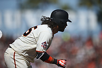 SAN FRANCISCO, CA - APRIL 3:  Brandon Crawford #35 of the San Francisco Giants runs to first base against the Seattle Mariners during the game at AT&T Park on Tuesday, April 3, 2018 in San Francisco, California. (Photo by Brad Mangin)