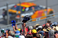 Apr 26, 2009; Talladega, AL, USA; NASCAR Sprint Cup Series fans wave as the field drives by on the pace lap prior to the Aarons 499 at Talladega Superspeedway. Mandatory Credit: Mark J. Rebilas-