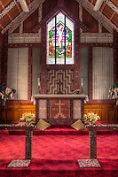 Cultural Syncretism.  Altar of St. Mary's Anglican Church, Tikitiki, north island, New Zealand, built 1924-26 as a memorial to Maori soldiers who fought and died in World War I.   Stained glass window shows Maori soldiers at the foot of Jesus on the cross.  Maori woven panels (tukutuku) decorate the walls.  A member of the New Zealand Historic Places Trust.  Highway 35, Gisborne Region.