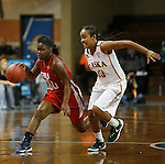 SIOUX FALLS MARCH 22:  TeTe Flowers #00 of Francis Marion dribbles past Alaska Anchorage defender Kiki Robertson #23 during their quarterfinal game at the NCAA Women's Division II Elite 8 Tournament at the Sanford Pentagon in Sioux Falls, S.D.  (Photo by Dick Carlson/Inertia)